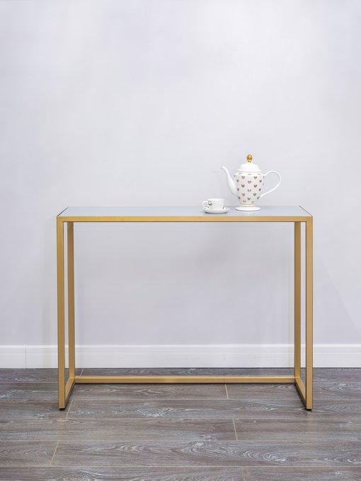 Консоль золотого цвета с серой матовой столешницей
