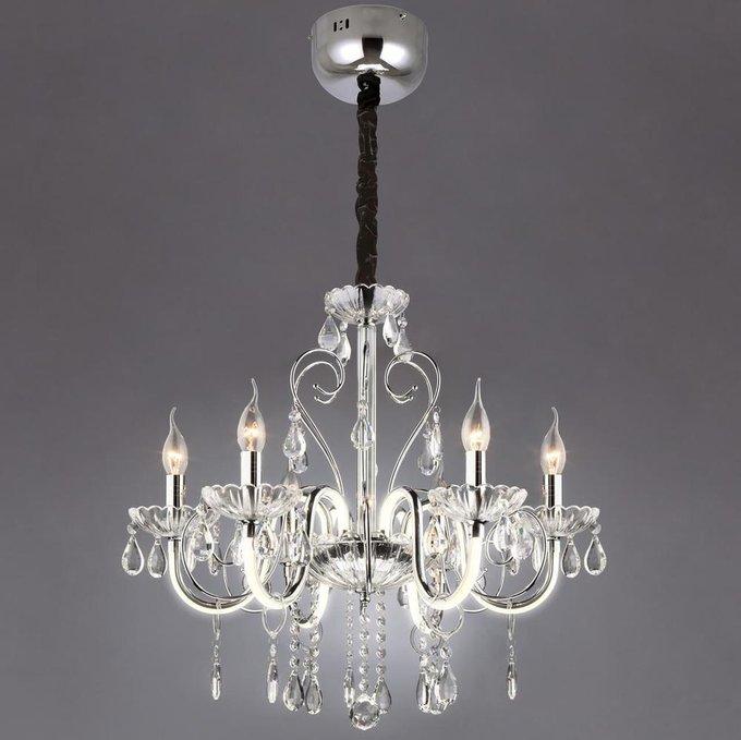 Подвесная люстра Bogates Liberty выполнена в виде свечей с хрустальными подвесками