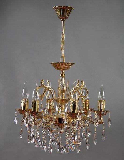 Подвесная люстра  Leon  в виде свечей с хрустальными подвесками