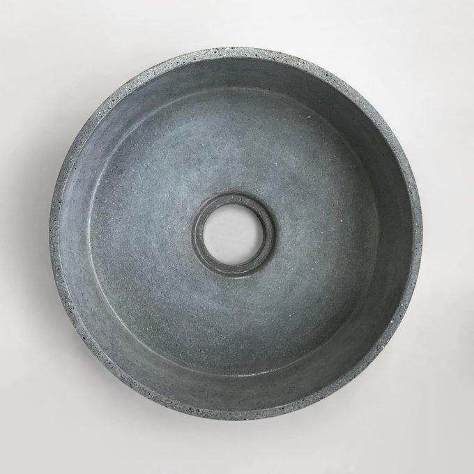 Раковина круглая серого цвета