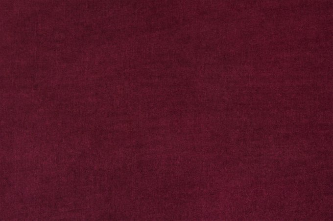 Подушка с обивкой из красной ткани