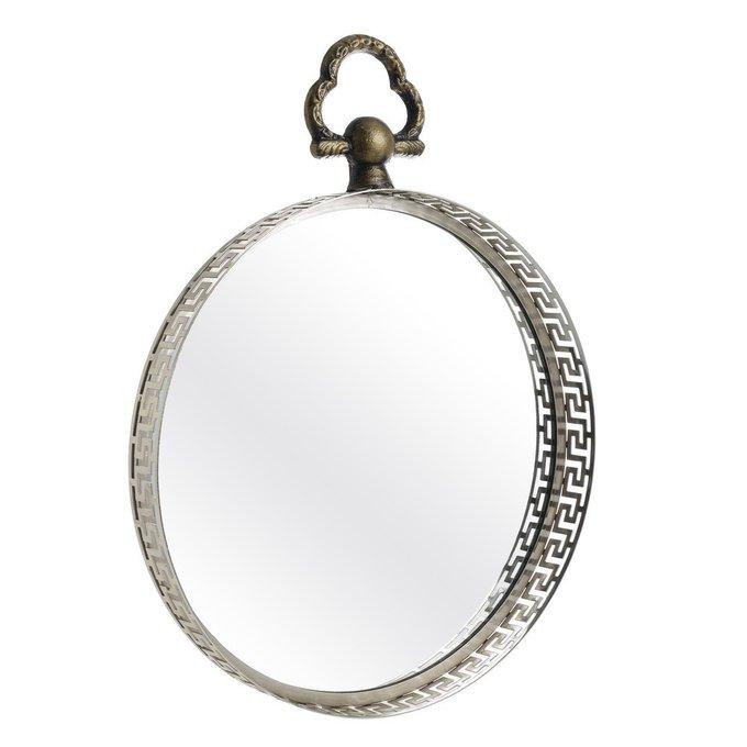 Настенное зеркало в металлической раме