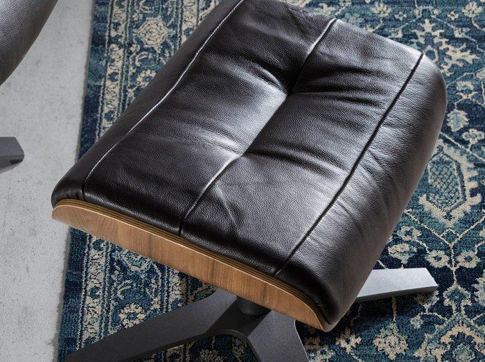 Поворотный пуф для ног  черного цвета