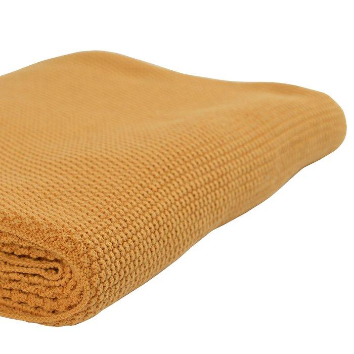 Плед вязаный Essential из хлопка цвета шафрана из коллекции 130х180