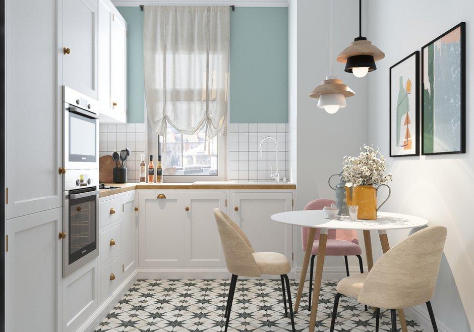 Акцентом в светлой кухне стала напольная плитка с принтом.
