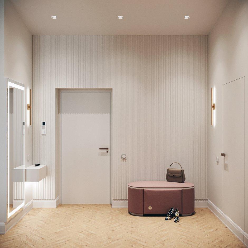 Для отделки одной из стен прихожей использовали рельефные гипсовые панели. Они добавляют динамики.
